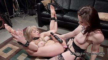 Golden-haired fisted and anal gangbanged in lezdom